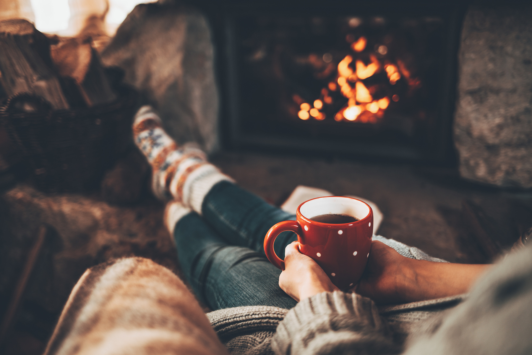 Cozy Woman by Fireplace AdobeStock 182331005